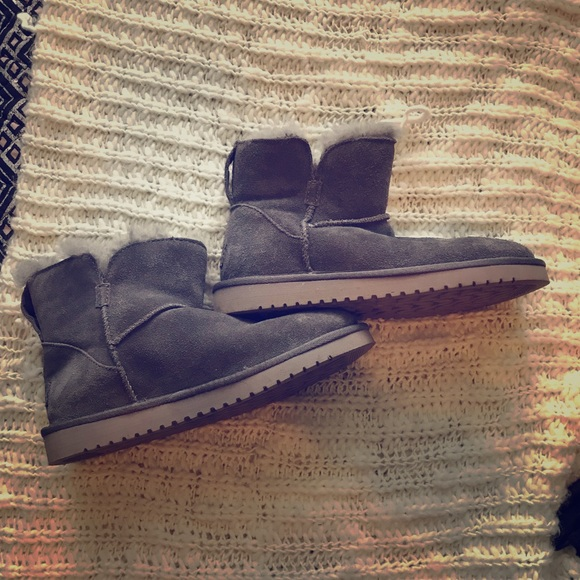 Grey ankle Ugg type boots.